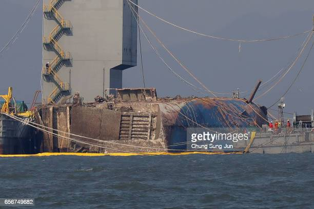 Submersible vessel attempts to salvage sunken Sewol ferry in waters off Jindo on March 23 2017 in Jindogun South Korea The Sewol sank off the Jindo...