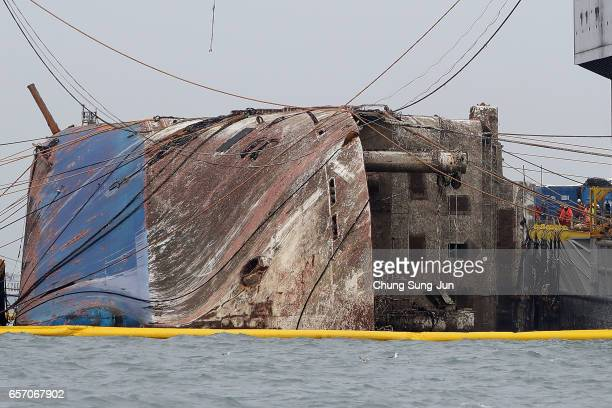 Submersible vessel attempts to salvage sunken Sewol ferry in waters off Jindo on March 24 2017 in Jindogun South Korea The Sewol sank off the Jindo...