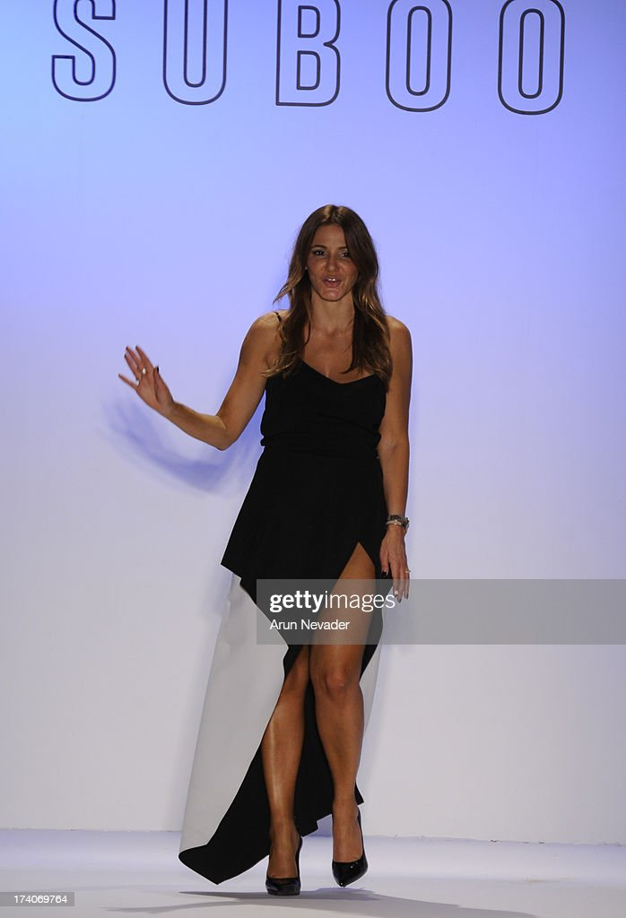 Suboo designer Sue Di Chio appears on the runway at the end of her show during Mercedes-Benz Fashion Week Swim 2014 at Raleigh Hotel on July 19, 2013 in Miami Beach, Florida.