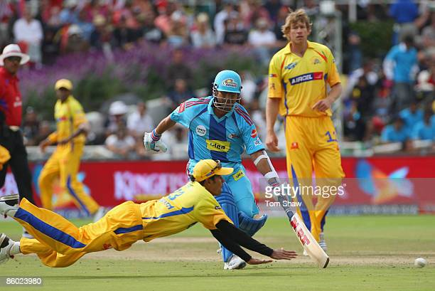 Subramaniam Badrinath of Chennai tries to run out Sachin Tendulkar of Mumbai during the IPL T20 match between Mumbai Indians and Chennai Super Kings...