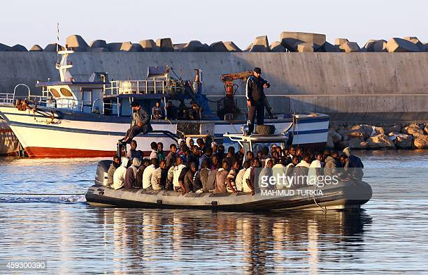 SubSaharan African migrants are rescued by the Libyan coastguard after their inflatable boat started to sink off the coastal town of Guarabouli 60...