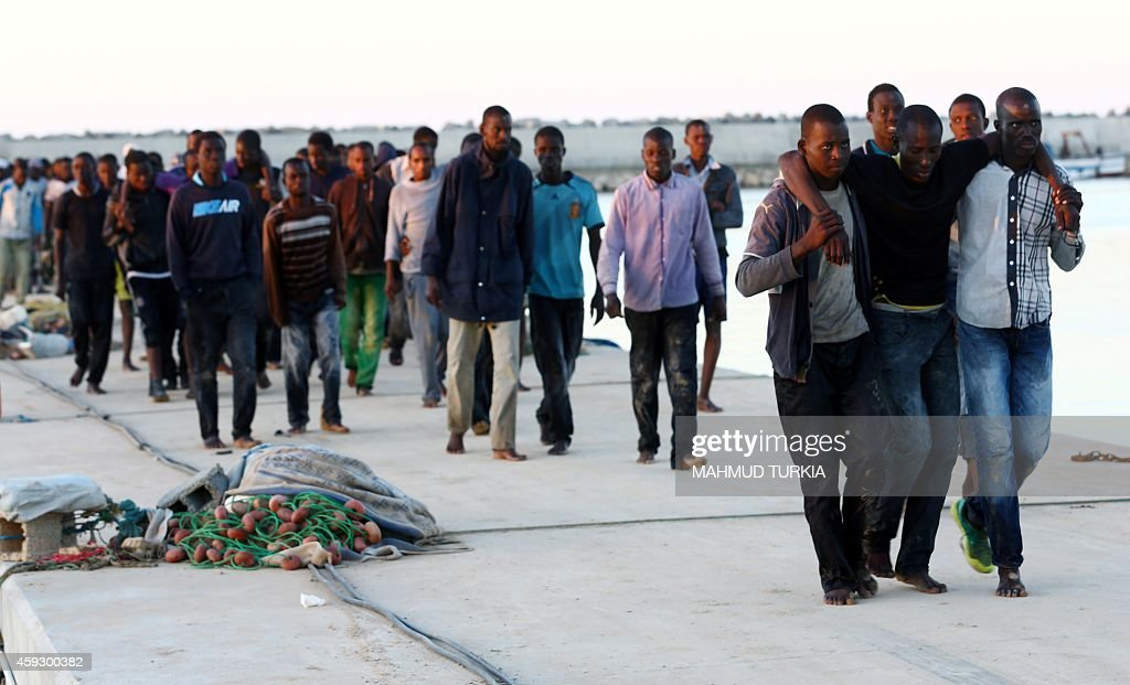 http://media.gettyimages.com/photos/subsaharan-african-migrants-arrive-in-the-coastal-town-of-guarabouli-picture-id459300382