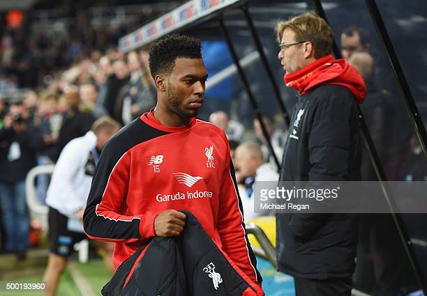 Substitute Daniel Sturridge of Liverpool walks to the bench past Jurgen Klopp manager of Liverpool prior to the Barclays Premier League match between...