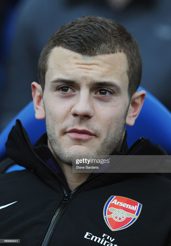 Substitute Jack Wilshere of Arsenal looks on prior to the FA Cup with Budweiser Fourth Round match between Brighton & Hove Albion and Arsenal at Amex Stadium on January 26, 2013 in Brighton, England.