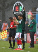 Substitute Javier Hernandez of Mexico stands on the touch line during the match during the 2014 FIFA World Cup Brazil Group A match between Mexico...