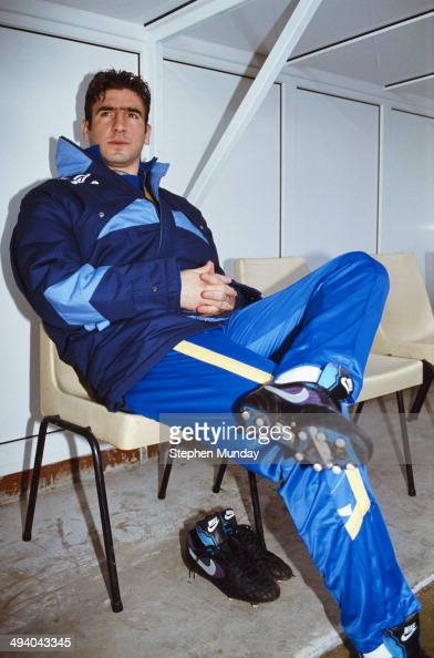 Substitute Leeds United forward Eric Cantona looks on from the bench prior to making his Leeds debut during the League Division One match between...