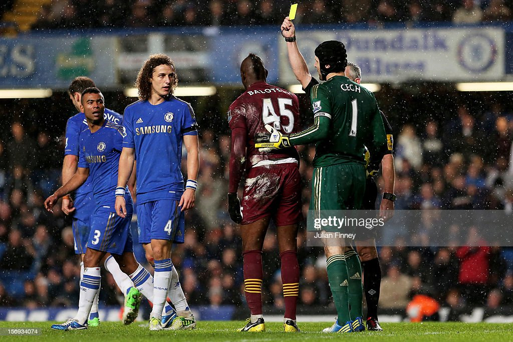 Substitute Mario Balotelli of Manchester City is shown the yellow card for diving by Referee Chris Foy during the Barclays Premier League match between Chelsea and Manchester City at Stamford Bridge on November 25, 2012 in London, England.