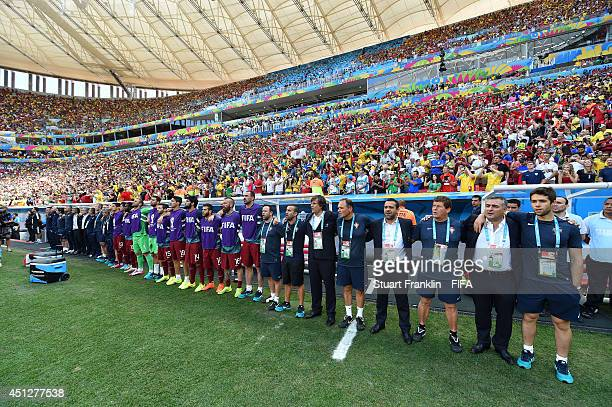 Substitute players and team staffs line up for the national anthems prior to the 2014 FIFA World Cup Brazil Group G match between Portugal and Ghana...