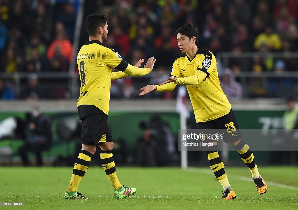 Substitute <a gi-track='captionPersonalityLinkClicked' href=/galleries/search?phrase=Shinji+Kagawa&family=editorial&specificpeople=4314029 ng-click='$event.stopPropagation()'>Shinji Kagawa</a> of Borussia Dortmund shakes hands with Ilkay Gundogan during the DFB Cup Quarter Final match between VfB Stuttgart and Borussia Dortmund at Mercedes-Benz Arena on February 9, 2016 in Stuttgart, Germany.