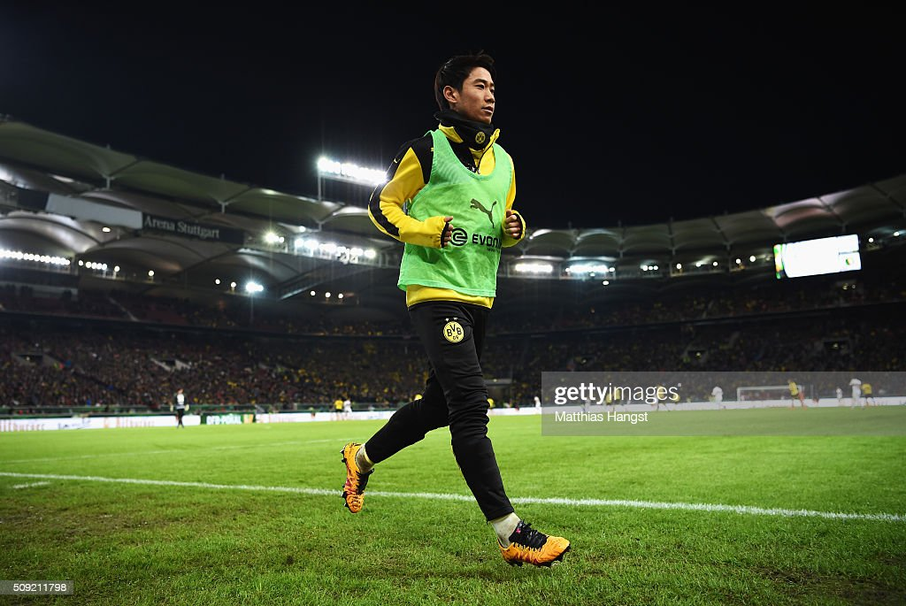 Substitute Shinji Kagawa of Borussia Dortmund warma up during the DFB Cup Quarter Final match between VfB Stuttgart and Borussia Dortmund at Mercedes-Benz Arena on February 9, 2016 in Stuttgart, Germany.
