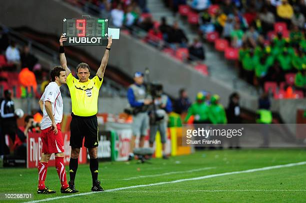 Substitute Tranquillo Barnetta of Switzerland waits by the touchline as the fourth official Martin Vazquez holds up the electronic board during the...