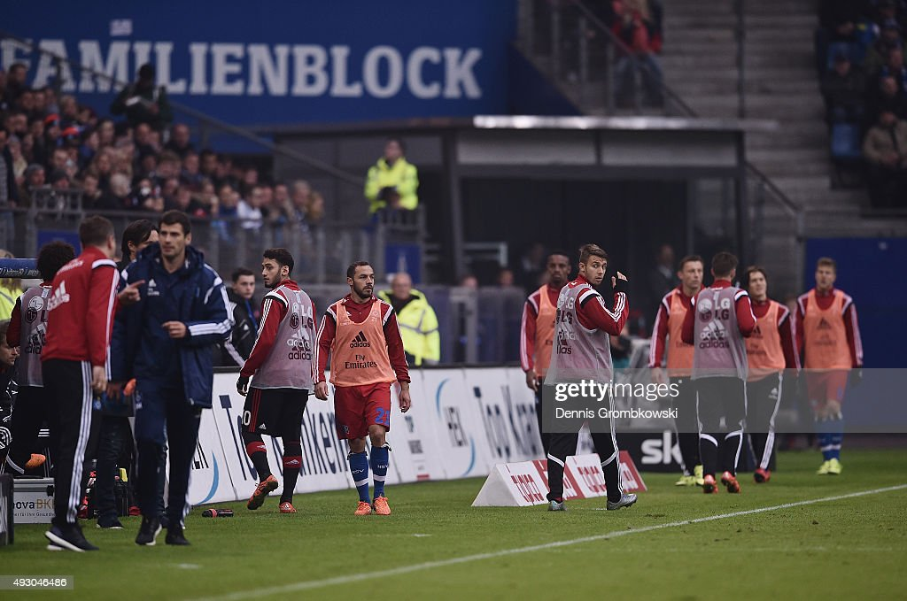 Substitutes swap warm up areas during the Bundesliga match between Hamburger SV and Bayer Leverkusen at Volksparkstadion on October 17, 2015 in Hamburg, Germany.