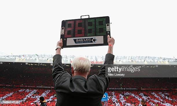A substitution board is held up acknowledging the 26 years of service and 38 trophies won by Manchester United Manager Sir Alex Ferguson during the...