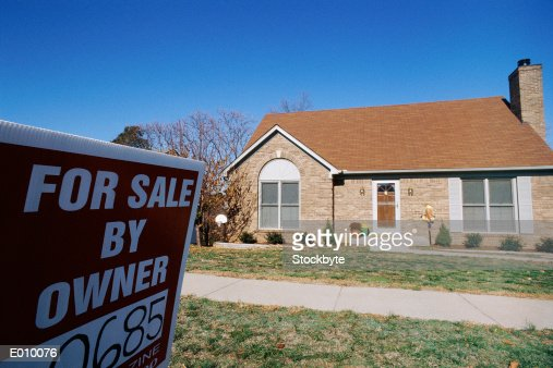 Suburban home with for sale by owner sign