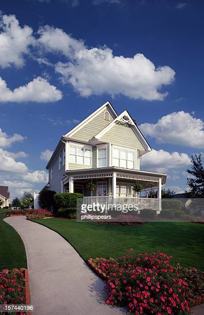 Suburban Home with Garden and fluffy clouds