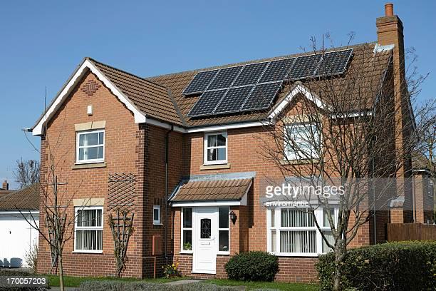 Suburban house with solar panels.