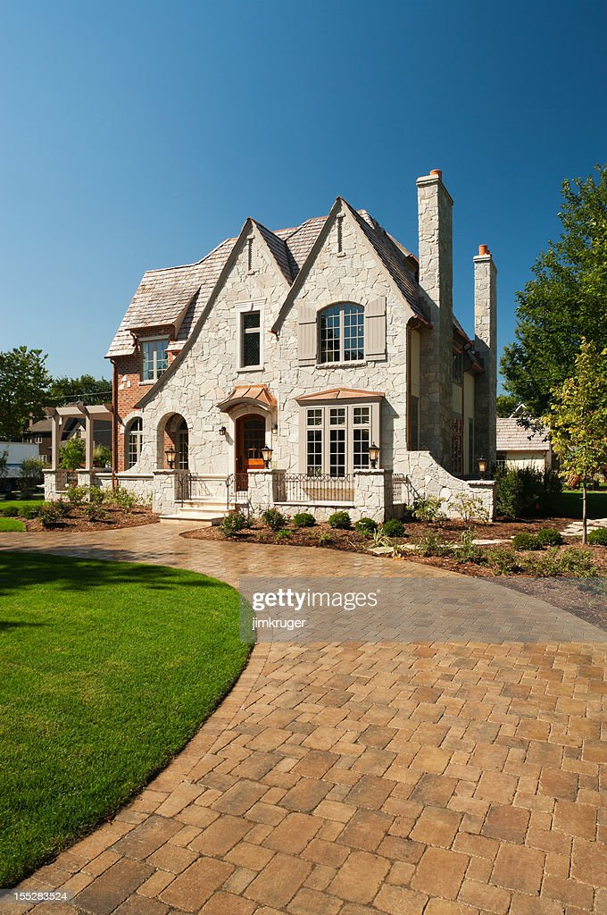 Suburban mansion with paver driveway. : Stock Photo