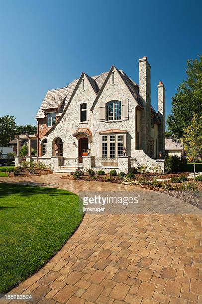 Suburban mansion with paver driveway.