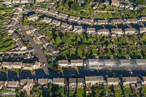 Suburban streets homes green gardens aerial view