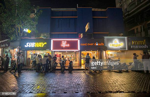Subway and other fast food restaurant on Linking Road at night on July 29 2015 in Mumbai India Linking Road is one of the popular shopping hub in...
