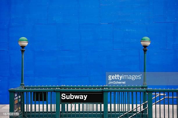 Subway entrance with green railing