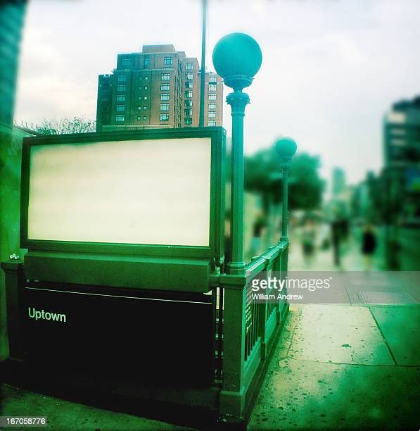Subway entrance with white billboard