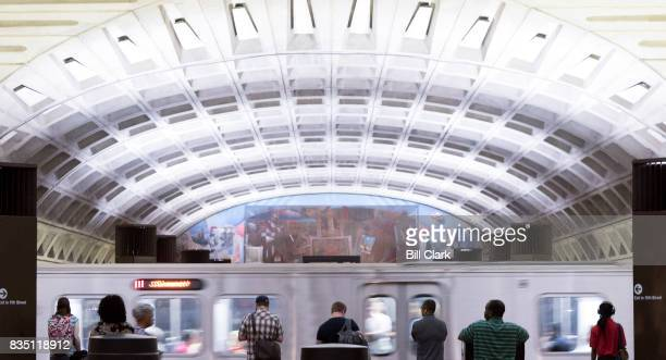 Subway passengers wait for their train at the Metro Center station in Washington on August 18 2017