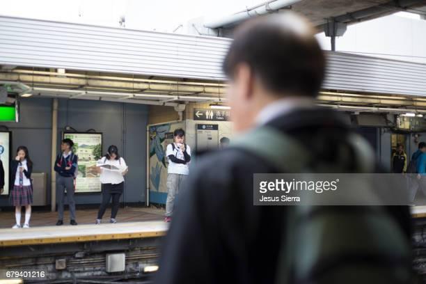 MTR subway. People in underground train, Hong Kong, China.