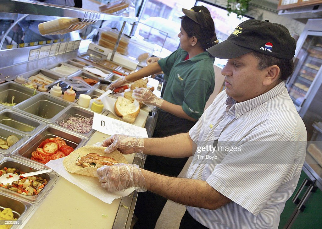 Subway restaurant store owner Shirish Dave prepares a new Chicken Bacon Ranch Wrap December 29, 2003 in Chicago. Subway restaurants today started to offer two Atkins Nutritionals, Inc.-endorsed low-carbohydrate wraps. The Turkey and Bacon Melt Wrap with Monterey cheddar cheese and the Chicken Bacon Ranch Wrap with Swiss cheese. Both Atkins-Friendly Wraps are available in the U.S. and Canada and have 11 grams Net Carbs or less. The wrap itself, which is made with wheat gluten, cornstarch, oat, sesame flour and soy protein, has only 5 grams Net Carbs. Subway Restaurants is the first quick serve restaurant to partner with Atkins Nutritionals Inc.