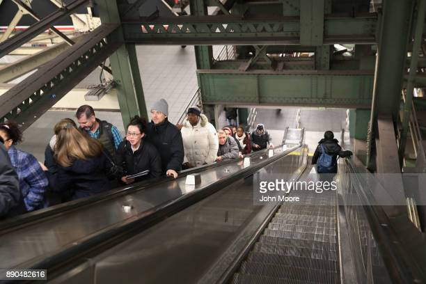 Subway riders emerge from near the site of a pipe bomb explosion on December 11 2017 in New York City Police said that Akayed Ullah a Bangladeshi...