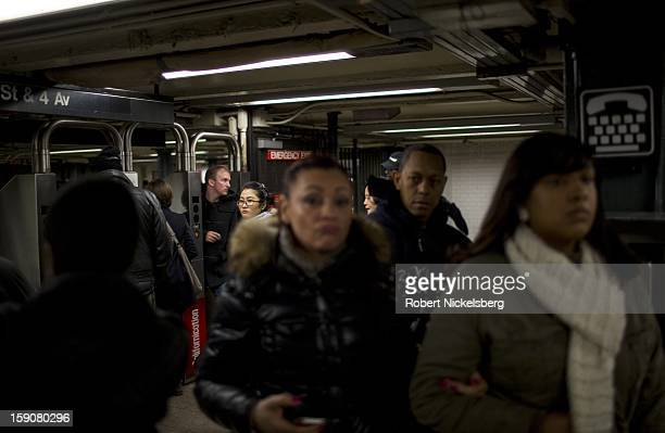 Subway riders enter a train station January 5 2013 in the Manhattan borough of New York