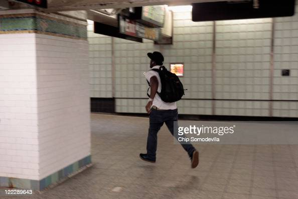 Subway riders run to catch some of the last trains to run thorugh the Times Square station August 27 2011 in New York City In anticipation of a large...