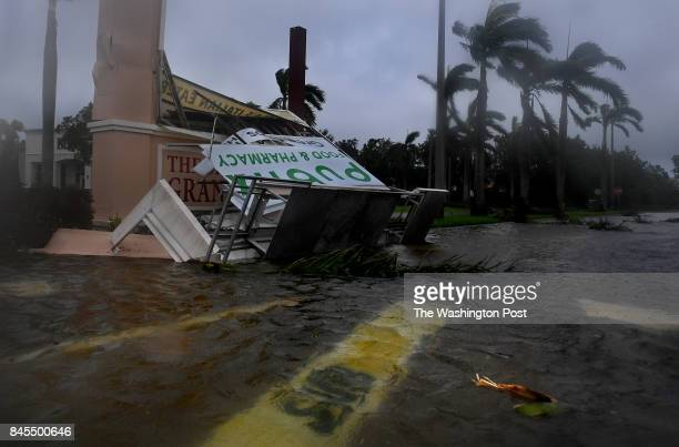 Subway sandwich shop sign is submerged and a Publix grocery story sign is badly damaged in Estero Florida after Hurricane Irma came through with the...