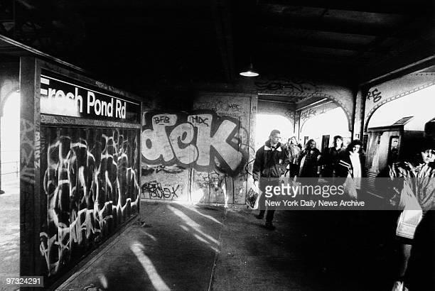 Subway station at Fresh Pond Rd with graffiti covered walls