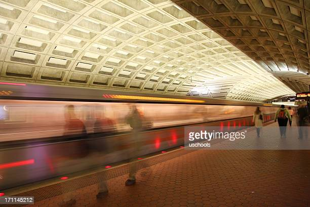 A subway train arriving or leaving from the platform in DC