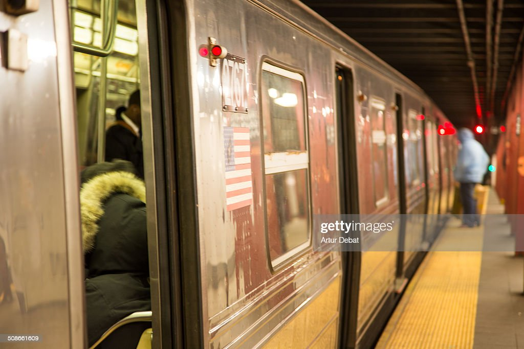 Subway train in the platform station in Manhattan city with people. New York City.