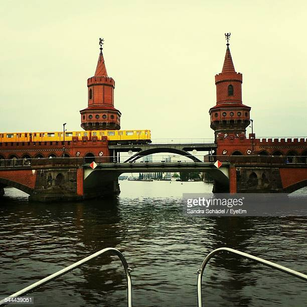 Subway Train On Oberbaum Bridge Over River Against Clear Sky