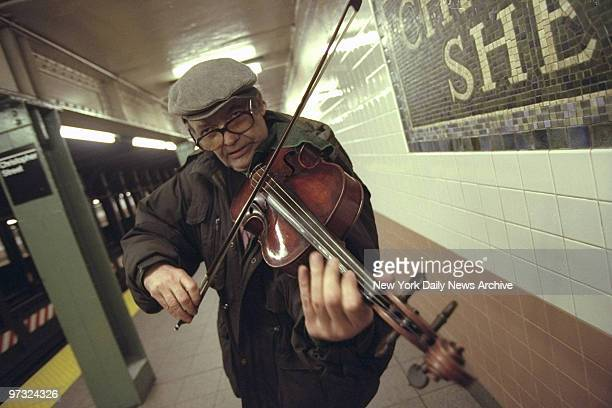 Subway violinist John Arms plays in the Christopher St station