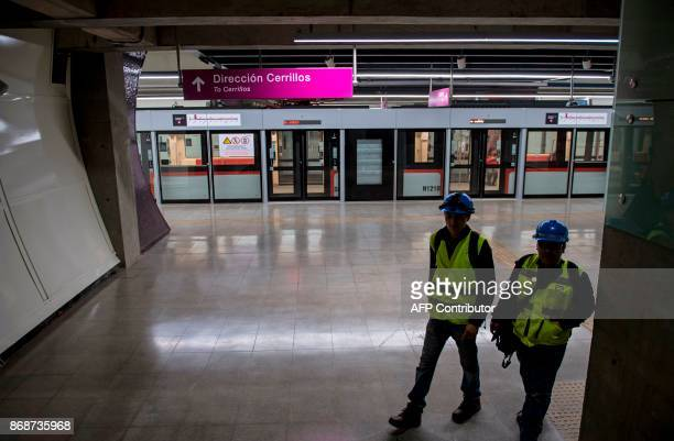 Subway workers inspect the last details of line 6 of the Santiago subway that will be inaugurated next November 2 in Santiago October 31 2017 The new...