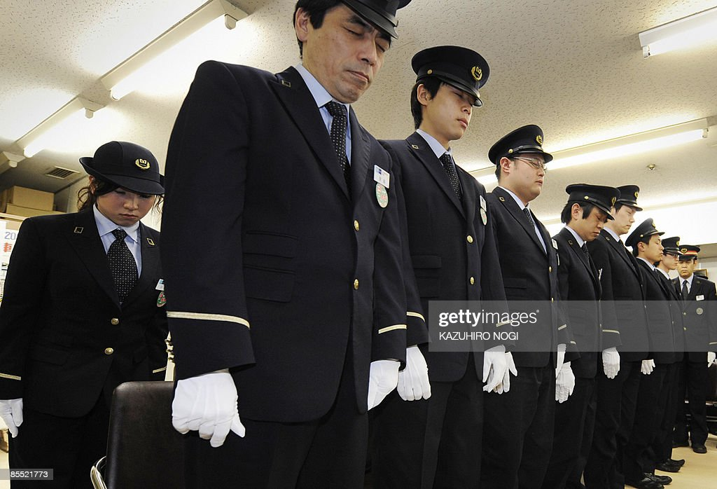 Subway workers observe a moment of silence for victims of the 1995 sarin gas attack by the Aum Supreme Truth cult group, during a memorial service at Tokyo's Kasumigaseki Station on March 20, 2009. The Aum Supreme Truth cult members killed 12 people and injured thousands when they spread Nazi-invented sarin gas on the Tokyo subway system on March 20, 1995. AFP PHOTO/Kazuhiro NOGI