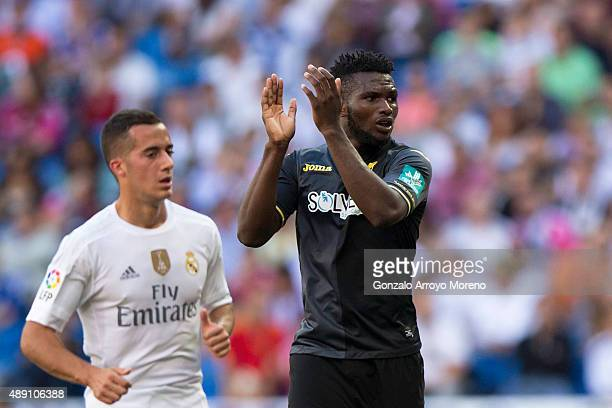 Success Ajayi Isaac of Granada CF claps behind Lucas Vazquez of Real Madrid CF during the La Liga match between Real Madrid CF and Granada CF at...