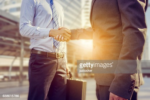 Success and Happiness concept, Businessman handshake at city outside office. : Foto stock