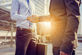 Success and Happiness concept, Business man handshake at city outside office.