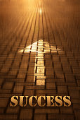 Success concept with arrow. Success word written on road at the sunset. Forward to infinity. Conceptual image for business strategy, planning, change, opportunity, progress, sport development and win