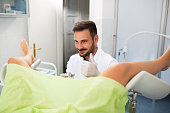 Success gynecologist examination, doctor with patient doing gynecology exam