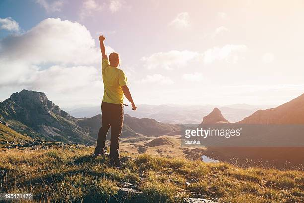 Success, winner concept. Man on top of the mountain.