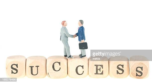 success word with business handshake