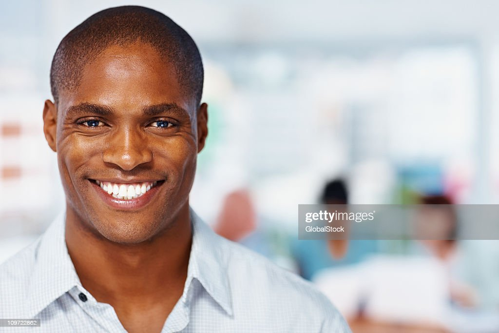 Successful African American business man smiling - copyspace : Stock Photo