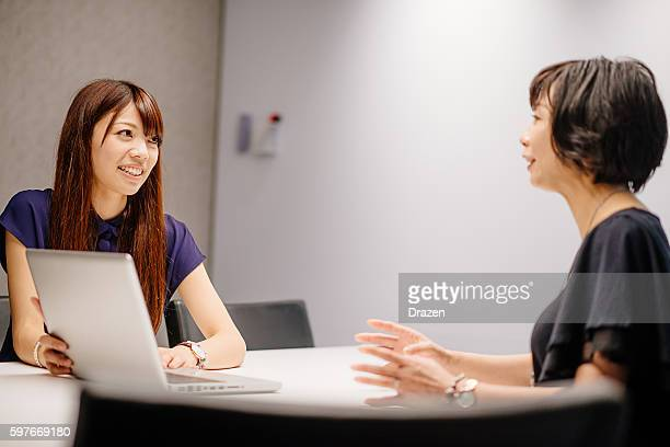 Successful Asian businesswomen in office