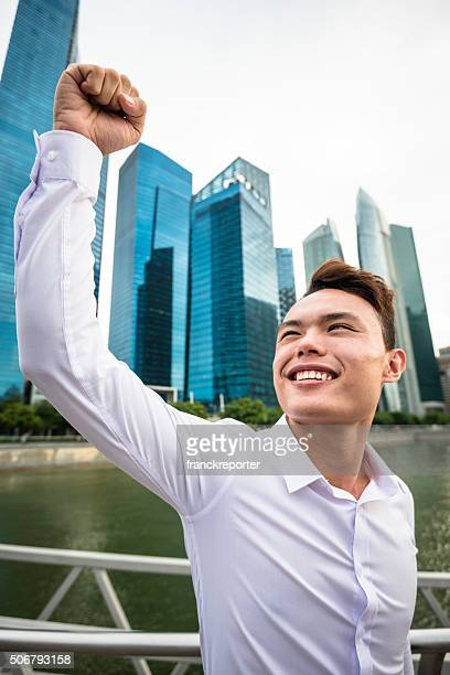 Successful business man against the skyscraper in singapore